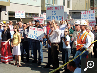San Francisco labor activists protest a construction contractor found guilty of cheating its employees out of wages and benefits.