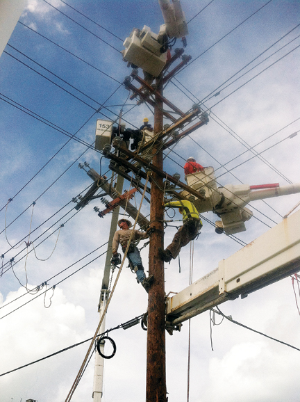 IBEW Local 113 And Traveling Journeyman Linemen Work To Restore Electrical Power After A Storm